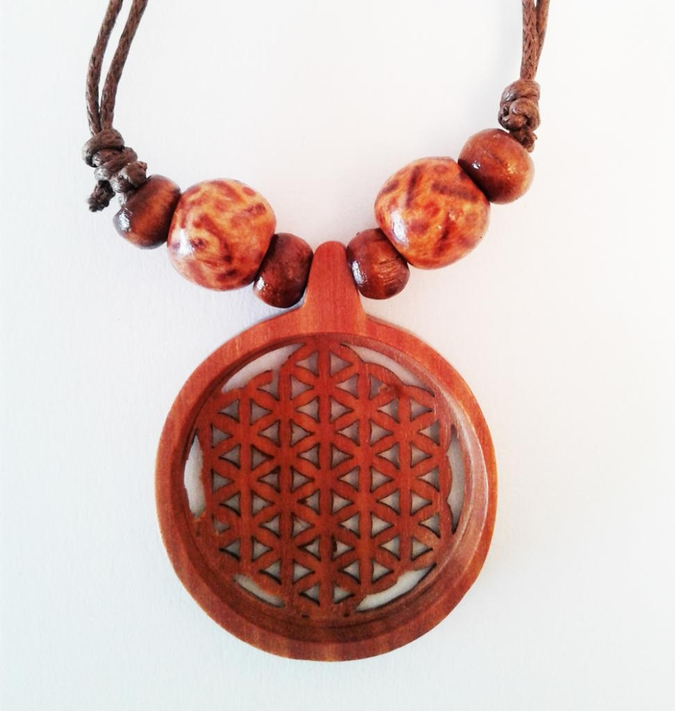 Fleur de vie pendentif en bois de sawo sculpté main. D. 3 cm