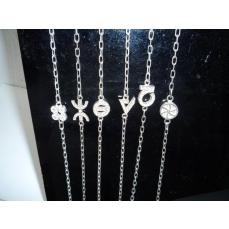 Bracelet argent massif chaîne avec les symboles de gauche à droite : chance, liberté, protection, force, optimisme et amour