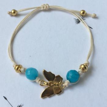 Bracelet fil blanc Papillon.