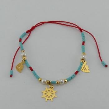 Bracelet fil rouge et pendentif Etain et bain d'or de 24 carats.